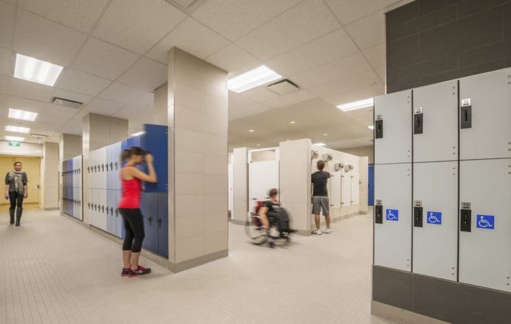 people use a locker room that includes a bank of lockers with the international symbol of access on them