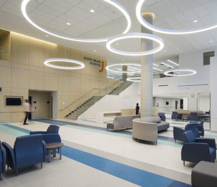 a spacious waiting area in the Joseph Brant Hospital with hanging circular light fixtures