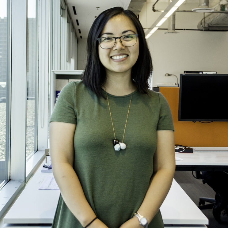 photo of Vien Nguyen standing in an office