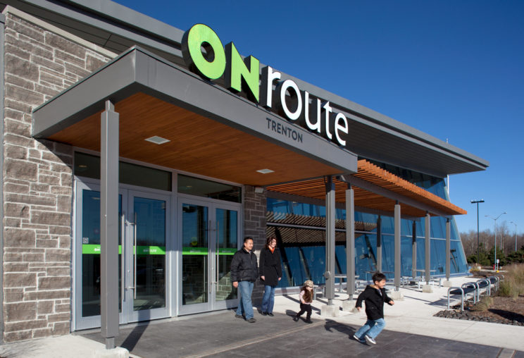 a family with two young children exit the Trenton ONroute Service Centre
