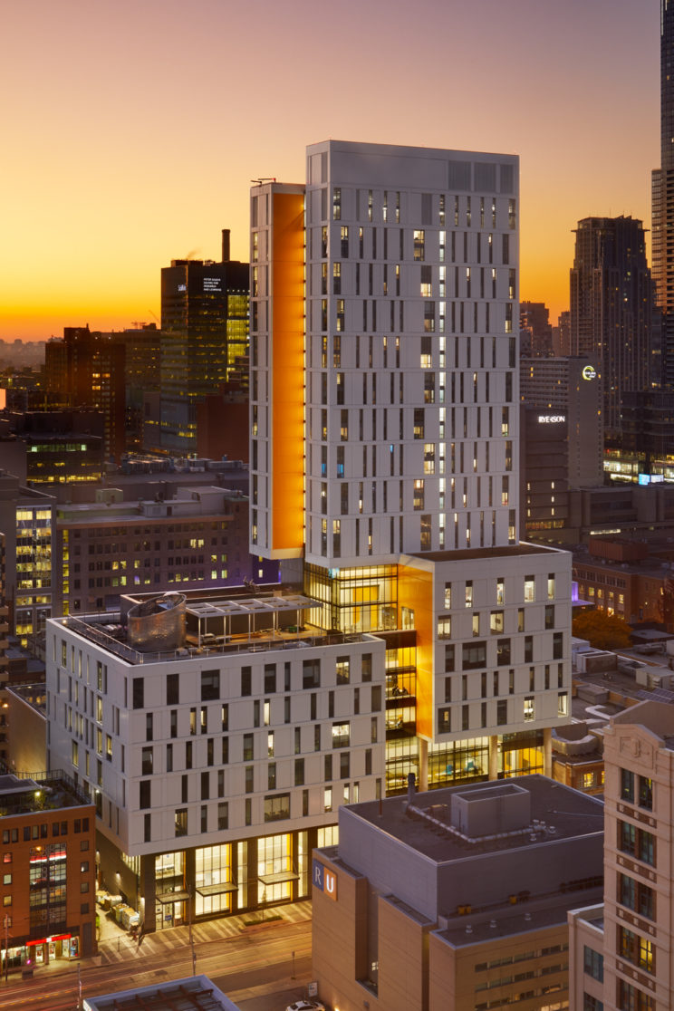 drone photograph of new white and yellow Ryerson University student residence tower and Health Sciences complex