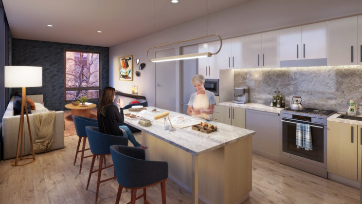 an older woman and a younger woman preparing a meal at their kitchen island in a modern condominium