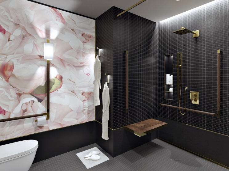 rendering of a bathroom with black tiles in the roll-in shower, a wooden bench and grab bars with polished brass details, and pink floral wallpaper