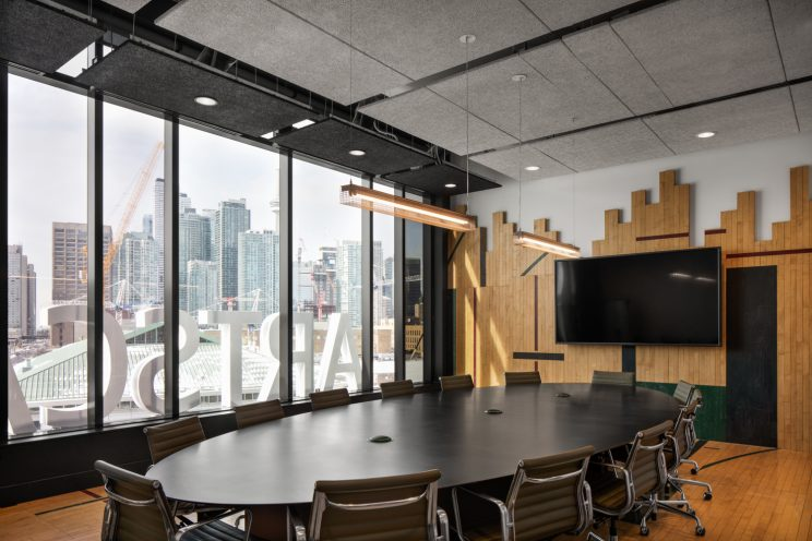 a boardroom with a wall made of reclaimed gymnasium flooring