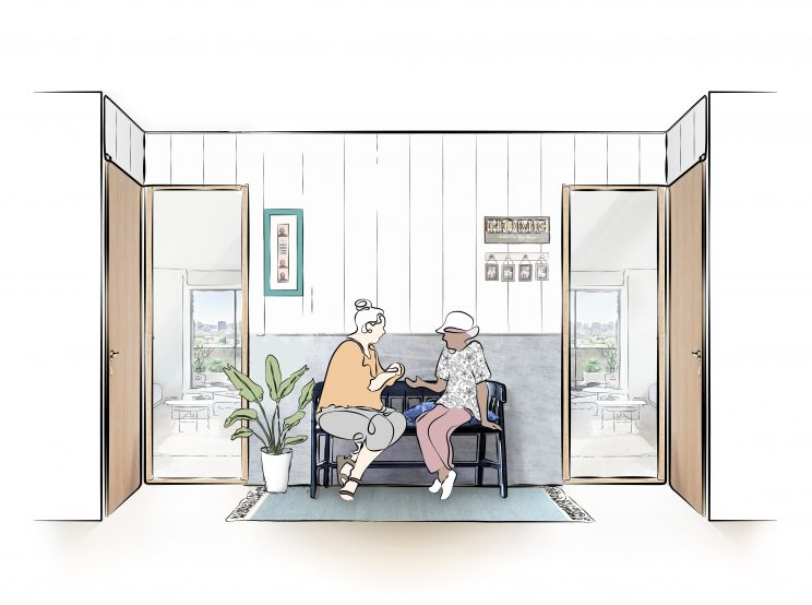 two older women chat on a bench in a building hallway between their apartments, in a nook that is decorated to be homey and welcoming
